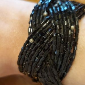 Woven black cuff bracelet with beaded accents